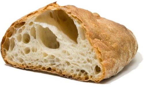 While developing our recipe for ciabatta, we continually encountered a vexing problem: loaves pitted with air holes so big, there was hardly any bread. So we wanted to know; would adding a small amount of milk—a technique often used by commercial bakers—fix the problem?