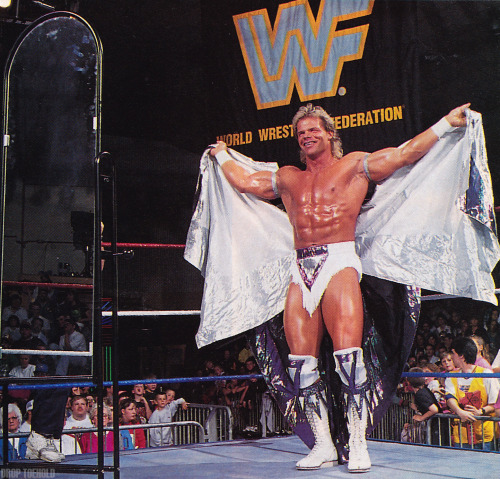 """The Narcissist"" Lex Luger Poses - WWF Monday Night RAW [4/26/1993] Growing up, this guy was one of my favorites due to the weird backstory that the World Wrestling Federation gave him. Luger had a steel plate inserted into his arm due to a motorcycle accident he had in 1992, and the WWF made this oddity part of his actual in-ring story as ""The Narcissist"" began to utilize a running clothesline [edit: forearm, whoops!] to knock his opponents out.  Such a strange thing to point out but completely believable to the mind and logic of a nine-year-old. I loved it."