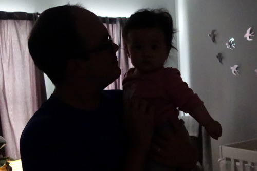 Day 232. Happy Eight Months to Eva, who's seen here in the moments before bedtime silhouetted by the light that still comes into her room when she goes down at seven o'clock.