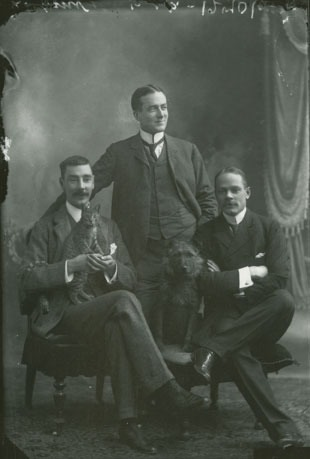 Best pals: H.M. Wylde's group, studio portrait with cat and dog, Halifax, Nova Scotia, ca. 1905.