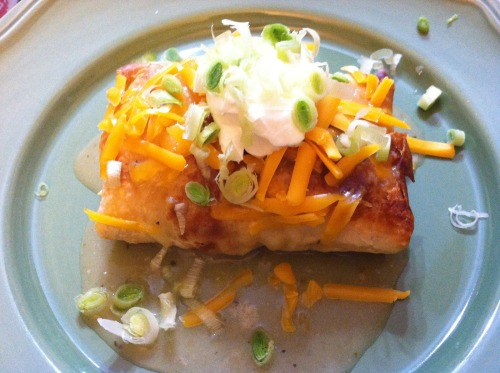 "Baked Chicken Chimichangas  Ingredients: 8oz Package Cream Cheese 8oz. Pepperjack cheese, shredded 1 1/2 Tbsp. taco seasoning 1 lb. Cooked Chicken, Shredded 8 Flour Tortillas Cooking Spray  Shredded Cheddar Cheese Green Onions, for Garnish Sour Cream Salsa  Directions: Stir together cream cheese, Pepperjack cheese and taco seasoning. Fold in chicken. Divide among flour tortillas. Tuck in sides, and roll up each tortilla. Lay seam side down in a sprayed 9x13"" baking dish. Spray tops of tortillas with cooking spray. Bake at 350 for 15 minutes. Turn chimi's over, and bake an additional 15 minutes. Serve with cheddar cheese, green onions, sour cream, and salsa."