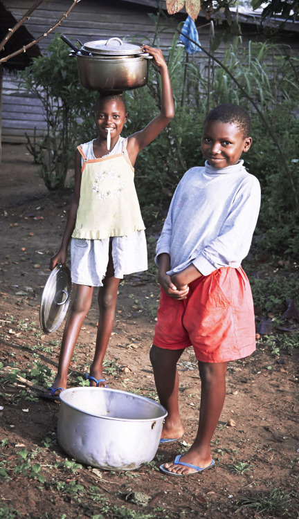 Two students start their day with a trip to gather water for their family's morning washing, eating, and drinking needs.    Learn more at http://thewatercollective.org