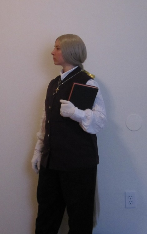 Enrico Maxwell. The wig is SUPER long! The very fine synthetic hairs made it tough to put into a ponytail, but I got creative and got it done. I wish this picture had turned out a little bit better though….