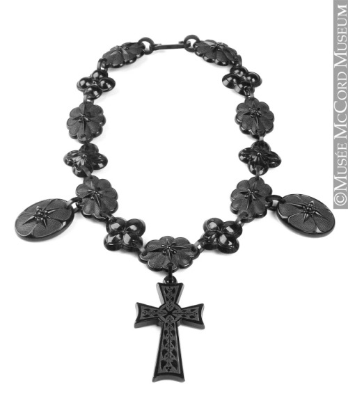 Mourning necklace, 1875-1900, McCord Museum  Perhaps surprisingly, mourning became an occasion for increased consumption. It might seem much more natural to expect that the grief associated with the death of a loved one would result in indifference to any form of consumption. But such was not the case in Victorian Canada. Paradoxically this deeply private time gave rise to eminently public rituals. Death imposed a number of rules, the most important of which specified the details of permitted activities and dress. To abide by the constraints of deep mourning, mourning and half-mourning, for example, a widow had to have dresses, shawls, bonnets, gloves, handkerchiefs and underwear in strictly codified colours. For many months, only black jet jewellery was allowed. To those who followed the codes, mourning was a time of heavy spending. What This heavy necklace with a gothic cross and medallions decorated with small flowers, probably pansies, is designed for mourning. It is made of a synthetic material imitating jet, a black stone.  Where Jet is a precious stone found in abundance near Whitby, England. In the Victorian era, the town had many manufacturers of jet jewellery.  When According to the rules of mourning, no jewellery was to be worn in deep mourning, the length of which depended on the degree of relationship to the deceased. Next came mourning, during which only jet was permitted, followed by half-mourning, when either jet or gold could be worn.  Who The owner of this necklace, who is unknown, was expressing her taste for the gothic, a style much in vogue in the 19th century. She also showed her very Victorian knowledge of the symbolic language of flowers, in which pansies represent thoughts.