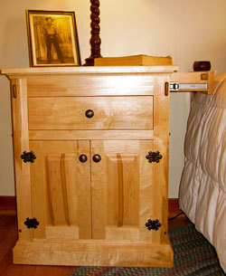 This custom nightstand has a secret drawer that pulls out toward the bed
