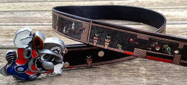 The Final Level Of Super Mario Bros., Now In Belt Form Here's a custom made leather belt featuring the entire final level of Super Mario Bros. for the NES. It was made by Julia of Salukifeathers and she's debating whether or not sell these on Etsy because she's not sure about the Copyright laws. Aw, who care's, Julia? There's blajillions of rad pieces of copyright infringement floating around on Etsy. And we feature most of it right here on our site! Check it: More Nintendo related awesomenessBuy: Super Mario Bros. 3 Belt Buckle