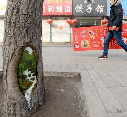 "Wang Yue calls the tree-hole paintings ""meitu"" which means ""beautiful journey."" The paintings on the trees have brightened the city during the dull, grey winter."