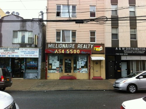 Millionaire Realty on Astoria Boulevard (near Crescent) still sports the old alphanumeric telephone exchange. Here, AS for Astoria — AStoria4-5500. Millionaire has been here for a long time—but then again, you can tell that simply by looking at it.