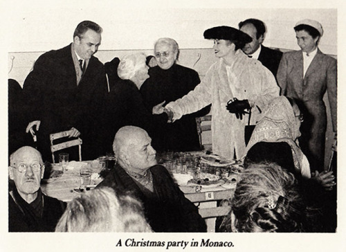 Prince Rainier and Princess Grace of Monaco at a Christmas party in Monaco in 1956.