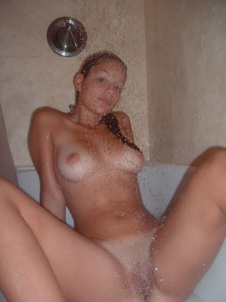 Hot nude girl taking a shower