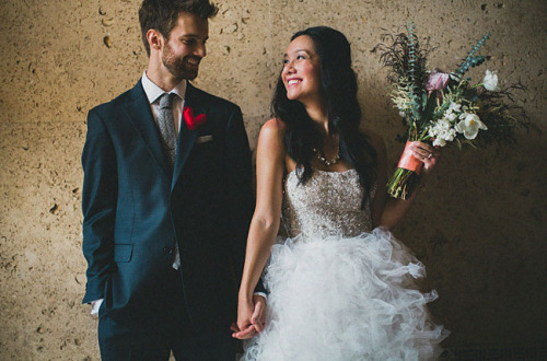 the bride's sparkly bodice wedding dress is by Monique Lhuillier