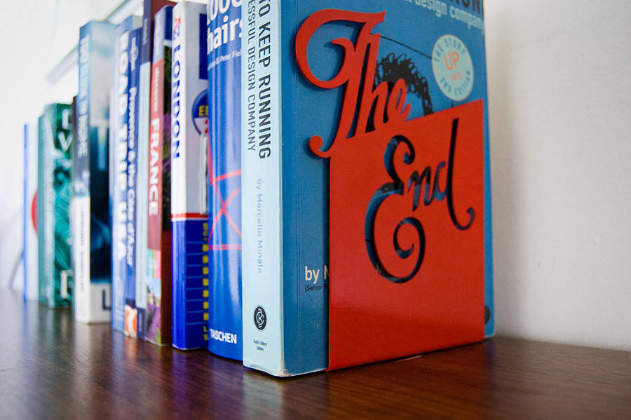 prettybooks:  'The End' Bookend  Oh this is fabulous. It's also something I'm looking forward to vis-à-vis my own novel(s).