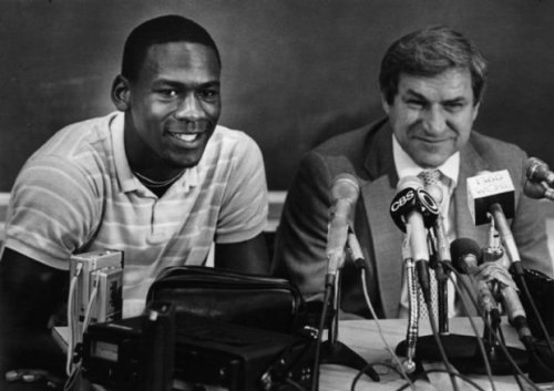 In 1984 Michael Jordan was all smiles as he and UNC coach Dean Smith announced that Jordan would forgo his senior year in college to play pro basketball.