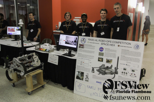 Students pose with their project during the FSU Digitech showcase on Friday, March 29th in the William Johnston Building. The event offers students an opportunity to display their innovations using technology.