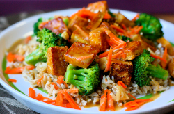 Soy-Mirin Tofu Over Rice with Broccoli and Peanut Sauce.