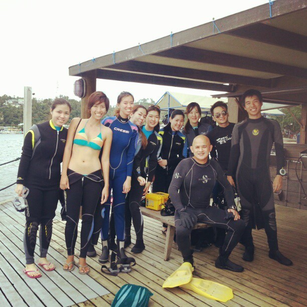 Diving in Puerto Galera with Dive Instructor John Mateos Ong Last Jan. 12-13, I managed to pull out just enough from what I have left in my savings (while ensuring I'd still have enough for my upcoming Iloilo-Bacolod-Dumaguete trip - I'm a super shoestring traveler, mind you) to join dive instructor John Mateos Ong's students for a weekend of diving at Puerto Galera. With Louie, Dive Instructor John, yours truly, and my age old friend Jane on the boat en route to Puerto Galera (photo c/o Michelle May Ong)  We arrived around 11, checked into El Galleon, had our lunch and looked forward to our dives at the renowned reefs of Puerto Galera. After squirming into our wetsuits, prepping our weight belts, masks, booties, fins, BCDs (Buoyancy Control Device), regulators and tanks (with the help of the Asia Divers staff) we'd be off to our first two dives of the trip. [[MORE]] Our BCDs, regulators and tanks all lined up and ready to go (photo c/o Michelle May Ong)  War of Nerves This would be my first time to go diving after my Open Water Diver Course at Liquid Dumaguete, and I was really nervous to be diving with someone other than my instructor Adam who made me feel so safe and secure in spite of my initial reservations. (I have very little confidence in my swimming skills and my ability to hold my breath and my ability to stay calm when something scares or startles me several meters below sea level) And after some tentativeness when water leaked into my mask on the surface (and delaying the second batch of divers), I finally got my shit together and began my descent. We had our first dives at Monkey Beach and Sabang Wreck, descending 21m and 19m respectively. They were relaxing and pleasant dives that helped get me comfortable in the water again after some time away. Unfortunately (or fortunately), I don't have pictures or a video of the dive, because as tempting as a GoPro Hero 3 is, I don't have the money to set aside for that right now. But that just means you'll have to go down for a dive yourself. :) (I'll share pictures here when John uploads his :P) The next morning, I woke up to a serene and quiet picture of this. (taken from my Instagram)  Drift Dive at The Canyons The day before John had asked the other girls if any of us was interested in diving with the more experienced boys in the Canyons. It was a drift dive (meaning the current would sort of take you on a ride), and was recommended only for advanced or experienced divers. I think all of us girls wanted to do it but were highly doubtful of our ability. John was confident he could guide a newbie through it provided that he only had to focus on one person. Since no one else wanted to, I decided to go for it and try to challenge myself a little before taking my Advanced Open Water Diver Course in Dumaguete this February. Flipping No Fins, You Won't Get Too Far We first dropped off at West Escarceo, where there was an abundance of corals as well, and a current. I thought the current was just making it harder for me to swim, when John pointed at my feet, and I lost a fin!! This setback cost my dive mates some time (sorry again, guys!) and we had to resurface because the Asia Divers dive master would not allow us to go on with me having only one fin (which at that point I felt I actually still could go on swimming with only one fin - like a Nemo). Good thing we replaced my lost fin though because our brief dive at West Escarceo did not prepare me for the current at The Canyons. Not to exaggerate, but there's absolutely no way I could have made that dive without one fin, let alone without holding on to someone. You could literally see the fish swimming as if they were on an aquatic treadmill. There was a point wherein I was in a sort of whirlpool going round because the current was so strong. It was my most stressful dive to date, but I was so glad to be in John's hands (quite literally). I was proud to have experienced it, in spite of losing my fin (and of course, having to pay for it :-S). We took a break before our last dive of the trip, and after the mild trauma of losing my fin and getting stuck in such a strong current (I was hardly able to notice the corals at that point, to be honest), I told John I'd sit out the next dive to The Canyons and go with the girls instead, so the boys could swim uninhibited. But with John's encouragement, I dove with them to The Canyons again. And I'm so glad he convinced me because it was not nearly as strong in current. and there was one point where we reached a little enclave with a lot of violet, purple, and fuschia-colored colors some 30 meters deep, and I really felt like Ariel in the Under The Sea scene right before Sebastian sings…sans the singing aquatic life. That has been my favorite dive in my few 10 dives so far. Thank you, John, for your faith in me. Hehe. With John's other students, Sophie, Candy, Aimee, me, our dive masters, Diana, May, Louie, Jane, and Aze :) Thanks for adopting me! :P (photo c/o Michelle May Ong)  Diving with John / Jong Any fears I had initially were unfounded, and it was nice to experience diving with another instructor, and if I had not planned to take my Advance Course in Dumaguete (since I'll be headed in the area), I would have utmost faith in John to get me through it, with his 8 years experience in diving, 6 years in teaching, his patience, and his passion in making diving possible for Filipinos. If you're looking to explore diving (and I think you really should! Our country is the perfect place for that and it's inexcusable not to experience it if you have the means to book trips abroad), check out Jong's Dive Course Schedule (you can also just join in for fun dives if you're looking for a group): Feb 9/10 : Open Water Diver Course Feb 16/17 : Open Water Diver Course Feb 23/24 : Advanced Open Water Diver Course Mar 16-18 : Coron Dive (fun dive) Mar 23-24 : Open Water Diver Course Mar 30-31 : Puerto Gallera Dive (fun dive) Apr 20-21 : Open Water Diver Course Apr 27-28 : Open Water Diver Course May 11-12 : Open Water Diver Course Aug 3-6 : Malapascua Dive (fun dive) For more details on rates, packages, and possible discounts, get in touch with John via e-mail at artist_ph[at]yahoo[dot]com or via mobile at +63917-8111471. Eat well, be merry, for tomorrow, you shall dive. ;) Jen