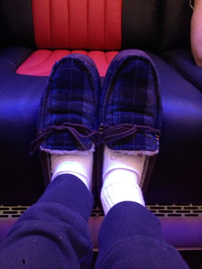 @NiallOfficial: Got me bus slippers on! the driver got them for us as a present !