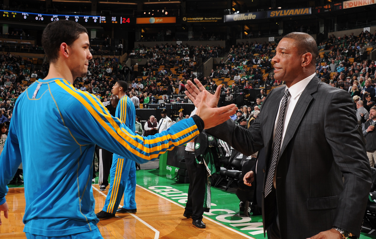 nba:  Austin Rivers of the New Orleans Hornets greets his dad Doc Rivers, head coach of the Boston Celtics on January 16, 2013 at the TD Garden in Boston, Massachusetts. (Photo by Brian Babineau/NBAE via Getty Images)