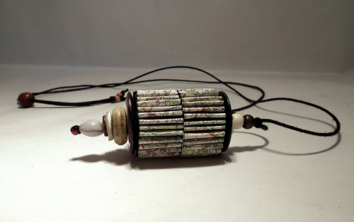 Tibetan prayer wheel inspired pendant on Flickr.