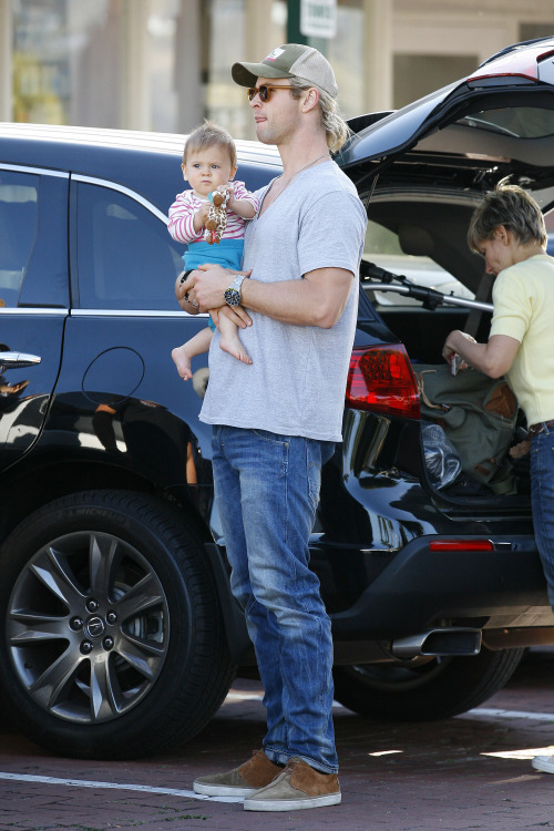 Chris Hemsworth still insists on carrying Baby India around everywhere, but now that she can hold her own head up, it's a little less scary to watch him do so. Also, although I am not a fan of bare feet or most horizontal stripes, I have to admit that this is a very cute baby.