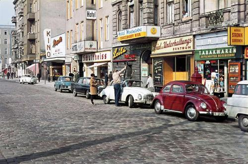 "west-berlin:  Stuttgarter Platz, Charlottenburg, um 1963  Die Gegend galt in den 60er Jahren als Nachtschwärmerviertel, wovon die ""Leila Tanz-Bar"" zeugt. An Stelle des Kinos Mascotte befindet sich heute ein Apartmenthaus mit Spielothek im Erdgeschoss. Die Hotels gibt es noch, sie heißen nur anders. Und das ""Montmartre"" hat keinen Stuck mehr. Die Entstuckung sollte die Häuser moderner machen.  Schön war die Zeit, als die Welt noch in Ordnung war- West-Berlin in pictures #228: Stuttgarter Platz, Berlin-Charlottenburg, ca. 1963 This area had been known as a quarter for nighthawks in the 1960s as the ""Leila Tanz Bar"" proves here. Instead of the cinema ""Mascotte"" there is an apartment house inclunding a casino on ground floor now, but the hotels are still there today, they have been just renamed. And the ""Montmartre"" lacks plastering nowadays because the removal should have made those houses look more modern. Photo: Heinz Noack"
