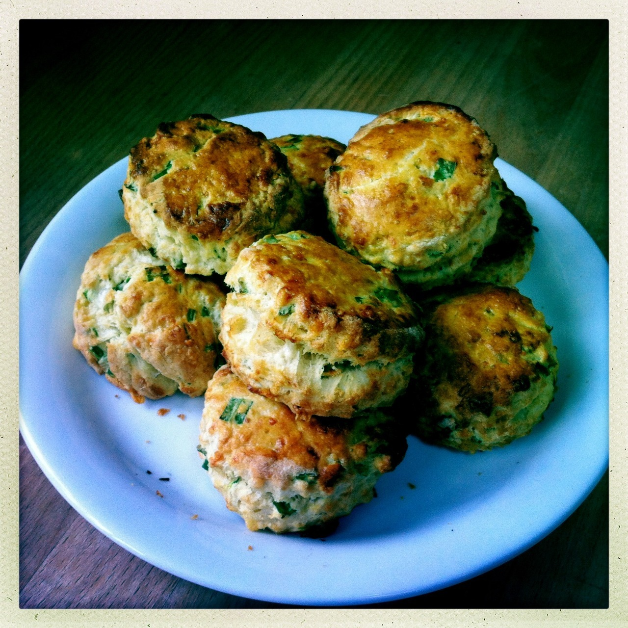 Cheese and wild garlic scones Whilst there's not much growing in the garden this time of the year, it's one of the best time for foraging as tender spring greens are beginning to appear. My favourite and luckily one of the most abundant is wild garlic, that grows in damp woodlands and along shady riverbanks all over the UK. It's similar to the north American plant known as ramps and its old English name ramsons is obviously linked. Unlike across the Atlantic, over here we eat the green leaves and not the small bulbs, which is presumably why it's becoming quite rare and even protected in some parts of America whilst in the UK it grows all over the place. I love the stuff and try and eat as much as I can during its short season, such as soup and risotto, or just added to a salad. These scones are something I dreamed up cycling home on a chilly damp day. Ingredients 8oz / 250g self raising flour 2oz / 50g butter 1oz / 25g strong cheddar, grated small bunch of wild garlic, chopped 1 egg, beaten 4 fl oz / 100ml milk Rub the butter into the flour and mix in the cheese and garlic. Mix the egg and milk together and gradually add to the mixture, kneading gently with your fingers until you have a soft dough. Keep a little of the liquid aside for later. Roll out on a floured surface to about 3/4 inch or 2cm thick and cut into rounds using a 2 inch / 5 cm cutter. Brush the tops with the remaining milk and egg mixture. Bake in a preheated oven at 220°C / gas mark 7 for 10 - 12 minutes. Cool on a wire rack, but try and eat them while they're still warm with plenty of butter.