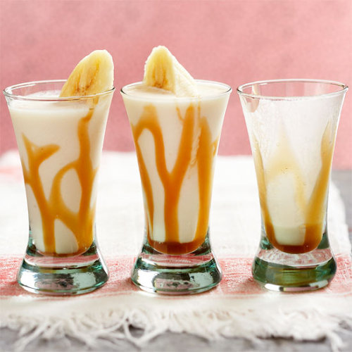itspartyrehab:  Bananas Froster ShotsIngredients & Measurements: 1 Banana 1 1/2 oz. Creme De Banana Liquor 1 1/2 oz. Spiced Rum 3 TBSP Whipping Cream 2 TBSP Caramel Ice Cream Topping 3/4 cup Ice Cubes Nutmeg Instructions:Cut up half of the banana and place in a blender. Slice the other half into 8 slices; set aside. Add creme de banana liqueur, rum, whipping cream, and 1 tablespoon of the ice cream topping to blender. Add ice cubes. Cover & blend until smooth. Drizzle remaining 1 tablespoon ice cream topping onto the insides of eight 2 oz shot glasses. Pour banana mixture into glasses. If desired, sprinkle with nutmeg. Garnish each glass with a banana slice.