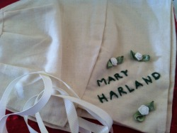 Bonnet tribute for convict lass Mary Harland made by staff and pupils at the Gladys Newton School, Balga, WA.   Mary Harland was born in dublin in 1793. She was a widow. Her trade was servant of all work. She was severely deaf. She stole a cage. She had no previous convictions. She was sentenced to transportation to New South Wales, Australia aboard the ship the Numa. She arrived in Port Jackson on 13 June 1834. Students performed a play highlighting Australia's colonial story and focusing on the female convict story with Mary Harland as a focal point.  Photos from the performance and a DVD accompanied the cloth bonnet tribute for Mary. Thanks so much to the Gladys Newtown School for involving Roses from the Heart as a way to highlight the female convict story.