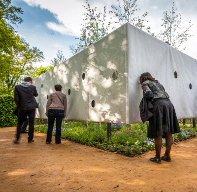 The 'Outside-In' garden by Paris-based architects Meir Lobaton Corona and Ulli Heckmann forces viewers to realize how special greenspace is by limiting the visible access.  When viewers peek through, four mirror-lined walls create an infinite garden.  More pics here.
