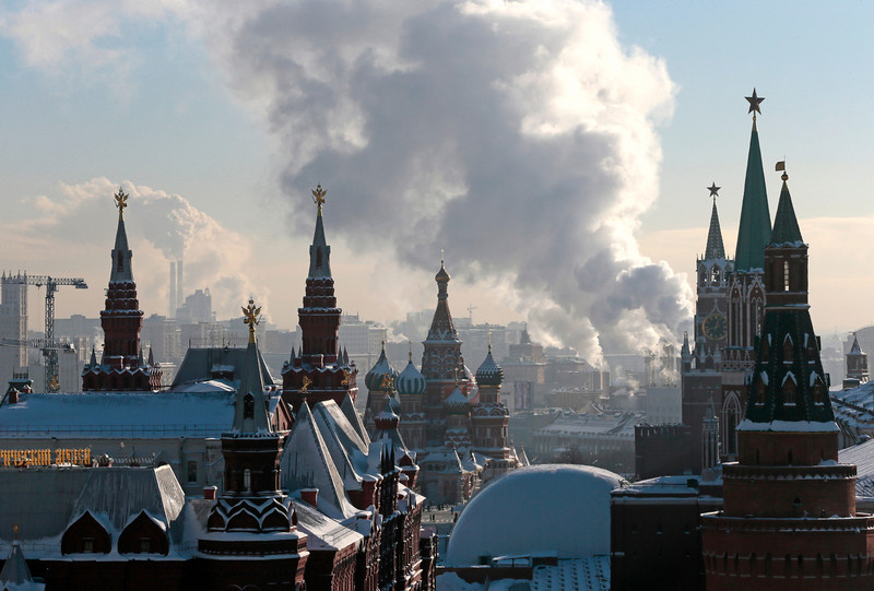 Steam from an electric power plant rises over Red Square with historical museum, left, St. Basil's cathedral, central, and Kremlin, right, in downtown Moscow, Russia on Jan. 23, 2013. The Lenin Mausoleum, bottom center, is seen covered for reconstruction. [Credit : Mikhail Metzel/AP]