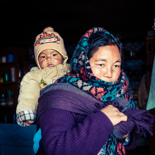 rucksackandacamera:   Nepalese baby and his mom, wrapping up to face the cold winter night. As we weren't very high at that point (only 2900m, which is low for Nepalese standards), it wasn't actually that cold, just slightly below freezing.   0