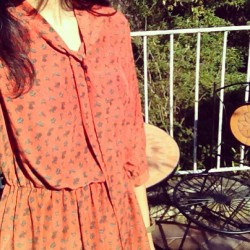 In the light of beautiful sun with grapefruit colored dress