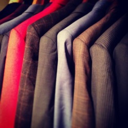 Final check on suit jackets before delivering to clients. Franc Lloyd- Custom Menswear
