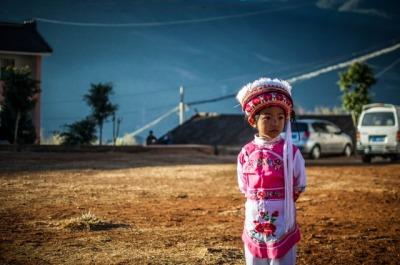 Photo of the Day: All Dressed Up in China A young girl in Baizu costume in Jizushan, Yunnan Province, China on December 27, 2012. (James Moallem) Want to see your images in our 'Photo of the Day' posts? Find out how.