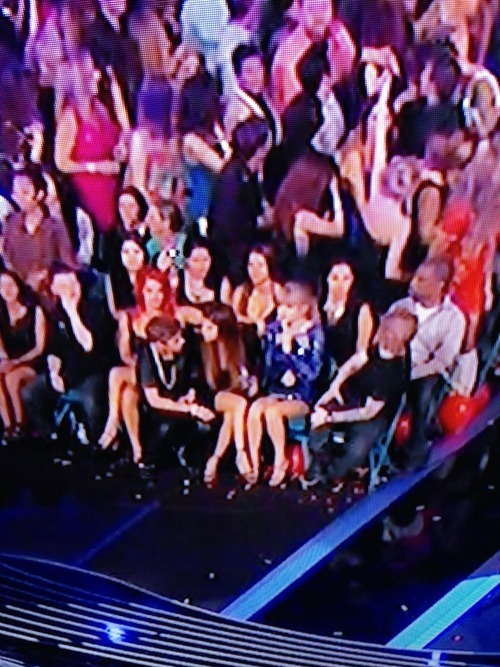 Selena and Justin sitting next to each other after Justin won.