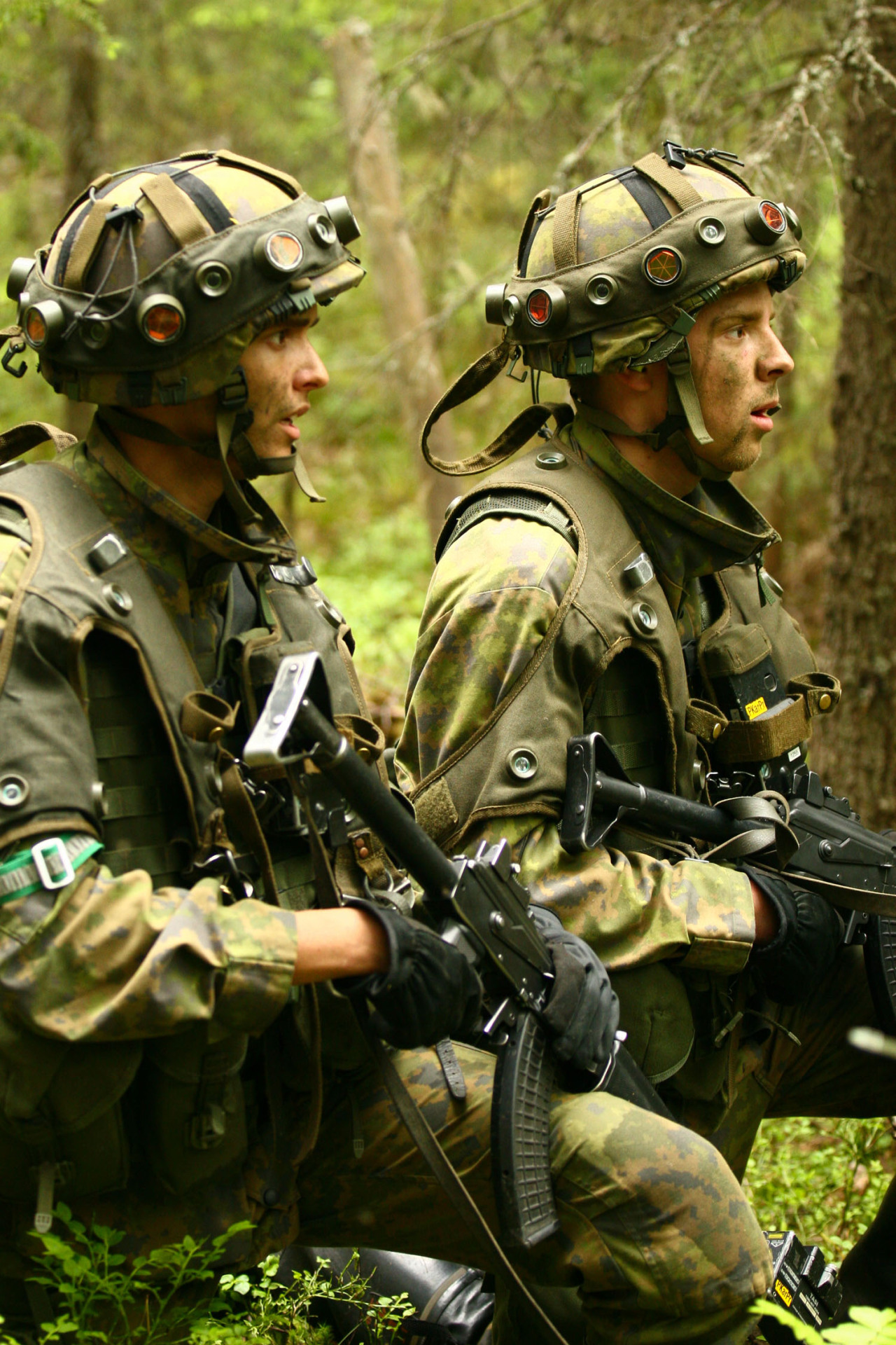 heavilyarmedhippie:  ohwasteland:  suomisodassa:  Finnish soldiers during military exercise ITÄ10  Can someone explain what that stuff on the helmets is, and how it works?  laser tag sensors. the guns are loaded with blanks- the blanks trigger the box at the end of the barrel, which shoots a laser beam. if it hits one of the flashlight-looking things on the helmets and vests, it makes a really loud and sustained beep, and lets the grader know that that guy just got blasted. expensive as fuck.  Perhaps expensive, but I would imagine it's cheaper than simunition, with a more realistic range for the weapons as well (ignoring the fact that lasers don't suffer from bullet drop or windage).