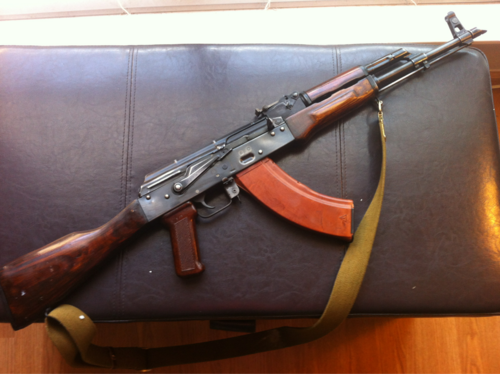 Russian Laminate wood furniture  sometimes seen with a wood grip or as  pictured with the russian Bakelite grip. FMJ 556 X45   AK GUIDE AROUND THE WORLD