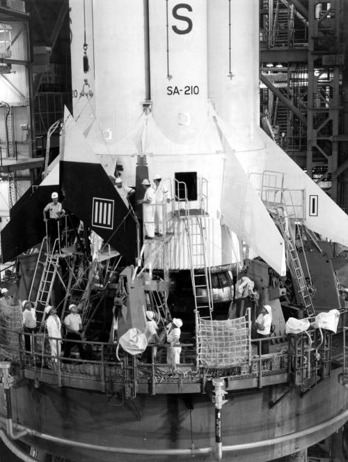 The replacement of fins on the Apollo Soyuz Test Project S1B launch vehicle continued at KSC today. The decision to replace all of the fins was made when small hairline stress corrosion cracks were discovered in holddown fittings. Replacement of the fins is not expected to delay move of the launch vehicle to the launch pad on March 24. ASTP, the joint U.S./USSR space mission is scheduled for mid-July.