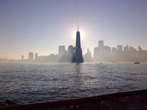shortformblog:  think-progress:  4259 days after Sept. 11, One World Trade Center now stands at full height of 1776 feet. Photo credit  A truly striking photograph of One World Trade Center, which as we mentioned yesterday was topped with a spire to raise the structure to its full height — 1776 feet.