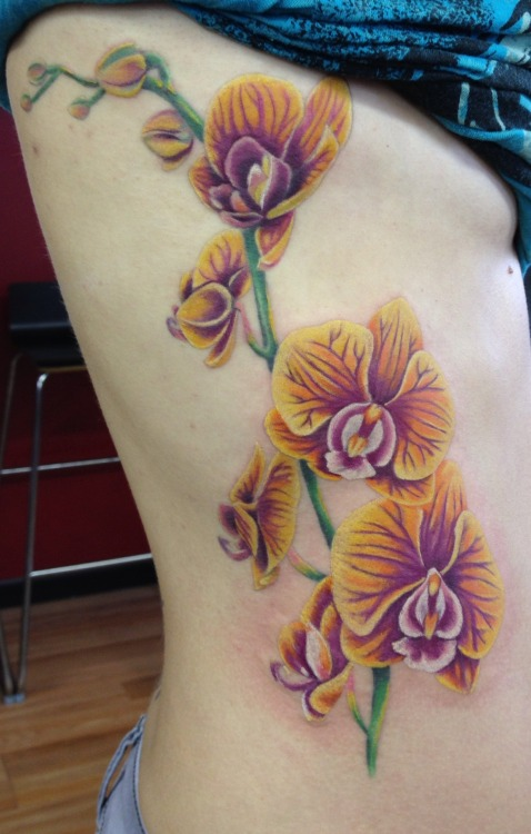 fuckyeahtattoos:  Orchid tattoo by Mindy Stewart at Studio XIII In Cocoa Beach Florida
