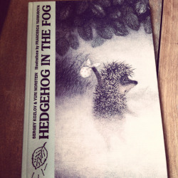 STAFF PICK (15% OFF!) - Hedgehog in the Fog by Sergey Kozlov & Yuri Norstein Based on an animated short film (Google it, it's worth watching!), Hedgehog in the Fogis Russian, dreamy, moody and gorgeously illustrated. A prickly little Hedgehog is on his way to visit his friend Bear. As he travels through the forest he encounters all sorts of animals and bugs - some who frighten him and some who help him along on his trip. Little Hedgehog gets scared and lost in the dark and in the fog, but he makes it safely to his friend Bear's house and thinks back on his trip while they both eat bread and jam and count the stars above. (Rebecca)