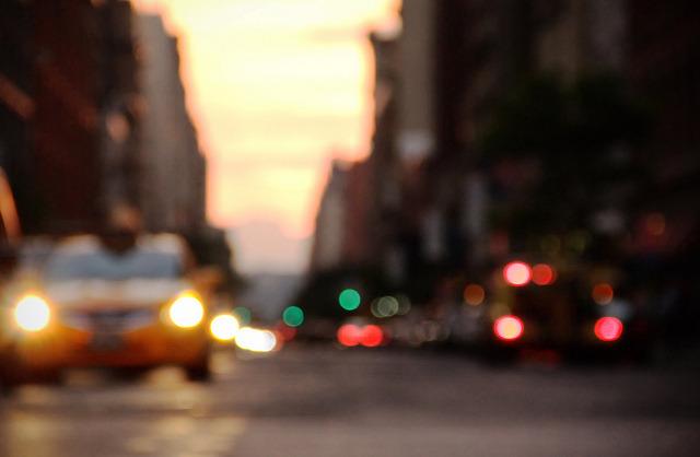 Manhattanhenge Bokeh on Flickr.Manhattanhenge happens in the burrough of Manhattan twice a year. The Sun sets parallel to all of the streets above 14th in Manhattan. Neil deGrasse Tyson explains the phenomenon in this video: www.sciencefriday.com/videos/watch/10222 .  MichaelTappPhotography.cominstagram.com/michaeltappFacebook PageMichaelTapp.com