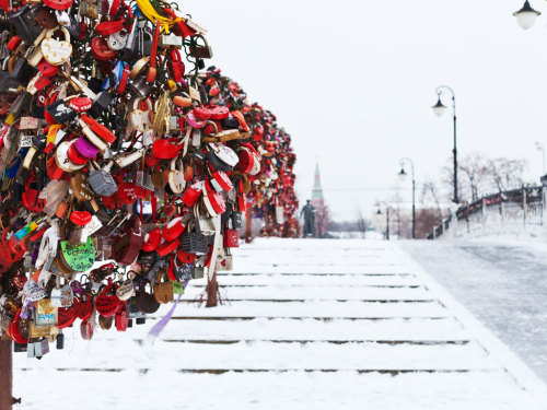 "condenasttraveler:  Luzhkov Bridge | Moscow, Russia  The tradition of attaching ""love locks"" (meant to symbolize a couple's everlasting love) to allegedly lucky spots is nothing new. (It's become a custom in Serbia, China, Italy, and France, among others.) One spot where the phenomenon is now especially popular is Moscow's Luzhkov Bridge, which features metal ""Trees of Love"" that were installed expressly for those coming to hang a padlock. Lovers inscribe a lock with their names or a personal message, and once the fixture is attached, the key for it is thrown over the bridge into the canal below—then, according to local legend, their union will remain unbroken."