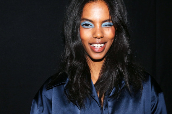 Grace Mahary backstage at the Topshop show in London, photographed by Emily Weiss for Into The Gloss.