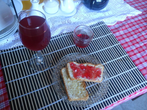 Multi-grain toast with cranberry-apple jelly and raspberry cordial. All homemade, of course.