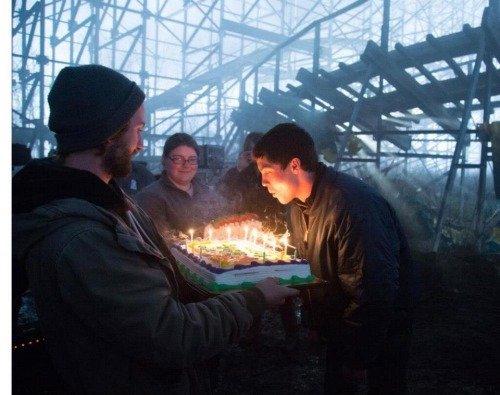 Logan Lerman blowing out birthday candles on the set of Percy Jackson: Sea of Monsters