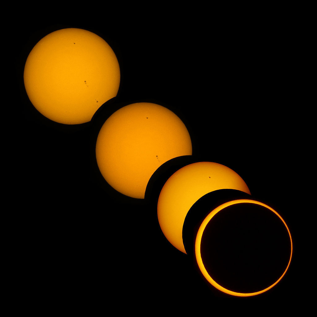 "What's An Annular Eclipse (Besides ""Beautiful"")? Do you love the sun so much you want to marry it? Well here's your band of gold. Annular refers to something ""ring-shaped"", and an annular eclipse is one that leaves us with a tiny stroke of light surrounding the opaque moon between us. Why are some eclipses complete and some are annular? It's just a coincidence, thanks to the elliptical orbits of the Earth, moon and sun. The Moon just happens to be about 400 times smaller than the sun and it's also about 400 times closer to Earth. And because it's in an elliptical orbit, sometimes it completely blocks out the sun when it passes perfectly between us (total eclipse) and sometimes it leaves a little around the edges (annular eclipse).  Still curious? Read more. If you happen to be out in the middle of the South Pacific on May 10, 2013, you can see one for yourself (with the right fliters and safety equipment, of course … never look at the sun!!). Unfortunately, most of us live on land, so this picture will have to do. (image via Wikimedia Commons)"