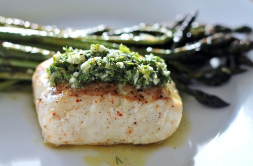 Halibut + Asparagus = Spring. This grilled fish was topped with a fresh seafood salsa verde straight from the herb garden. Seafood Salsa Verde 6-8 sprigs flat leaf parsley, chopped 3-4 sprigs fresh dill, chopped 1-2 sprigs fresh thyme 2 cloves garlic 1/2 lemon, zested and juiced 1/4 cup olive oil Salt and pepper to taste Combine all ingredients into a small food processor and pulse until well-combined.  Reserve and top any grilled fish or poultry, including this first-of-the-season halibut.