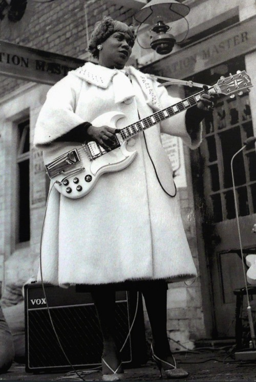"explore-blog:  Sister Rosetta Tharpe – gospel music's first superstar, the godmother of rock and roll, ""the original soul sister,"" reconstructionist – waiting for The Blues Train in Chorlton, 1963."
