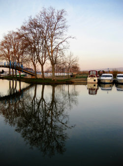 Reflections on the Canal du Midi. Homps, France. Photo by Amber Maitrejean